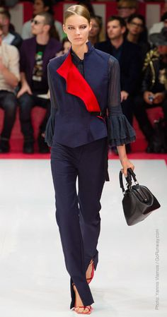 OBSESSED with this @Acne Hub look. A slender #chic look with #ruffles and a dash of #color