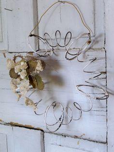 Rusty metal recycled wreath salvaged bed springs primitive farmhouse wall decor Anita Spero. $35.00, via Etsy.