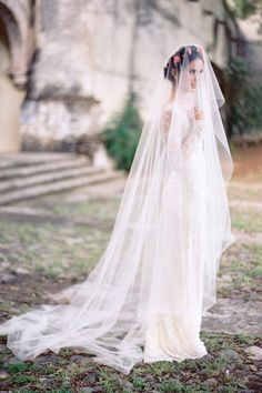 Cue the drama, this long chapel length veil is where it's at.   - HarpersBAZAAR.com