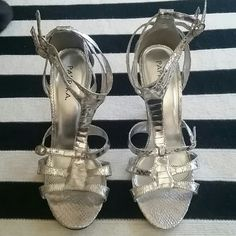 Sexy strappy silver heels Sexy silver strappy heels, reptile pattern, brand new & never worn. Paprika Shoes Heels