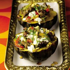 Roasted Acorn Squash with Turkey Sausage, Peppers, and Goat Cheese