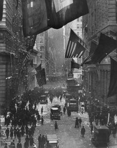 Crowds on Wall Street celebrating the end of World War I, New York City, 1918.