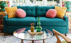 Sit, stretch and sleep on this Mid-century beauty that's equal parts sofa and bed in a sleekly tufted package. Turquoise Couch, Teal Couch, Yellow Sofa, Blue And Yellow Living Room, Colourful Living Room, Teal Rooms, Pink Room, Teal Walls, Mustard Living Rooms