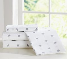 Star pillowcases with striped or gingham bedding for boys' rooms