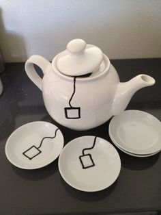 A vintage teapot for 1,25 euros, teabag platters and a porcelain pen. Inspired by the teamug in my 'Let's DIY' board. Very simple to make!