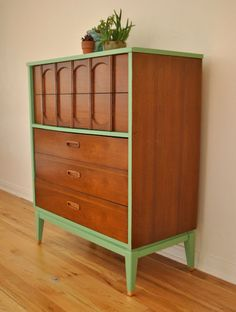 The mint green accents on this dresser totally liven it up!