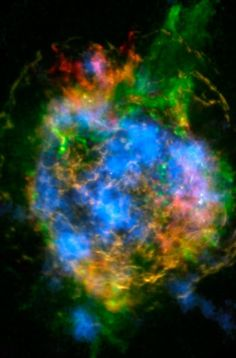 Untangling the Remains of Casiopeia A | The mystery of how Cassiopeia A exploded is unraveling thanks to new data from NASA's Nuclear Spectroscopic Telescope Array, or NuSTAR. In this image, NuSTAR data, which show high-energy X-rays from radioactive material, are colored blue. Lower-energy X-rays from non-radioactive material, imaged previously with NASA's Chandra X-ray Observatory, are shown in red, yellow and green.