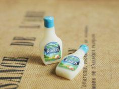 Tiny ranch dressing bottles