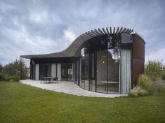 Rodinný dům ve tvaru srdce využívá atypické detaily a materiály   EARCH.