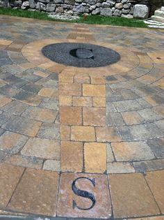 Paver driveway with custom compass rose and Corinthian granite medallion