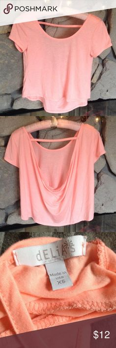 Coral short sleeve cropped shirt drape back Juniors coral shirt, short sleeve, drapes in back, made by Delia's SZ S.  Worn maybe once or twice, from smoke free home. delia's Tops Crop Tops