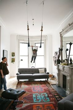 If swings seem a bit tame to you, why not try a trapeze? This one is located in the living room of a Brooklyn home spotted on A Cup of Jo.