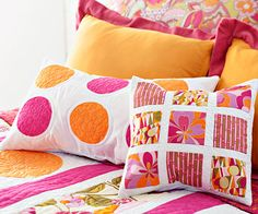 Squares and Circles Pillows - Machine-appliqued circles, simple strips, and rectangles make these bright pillows a snap from start to finish.
