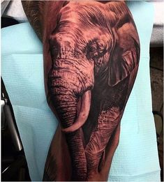 28. The realistic elephant leg design. Here is the amazing variant of an enormous adult elephant on the leg. The animal is performed in full growth with a trunk down that expresses strength and power. The forms and colors are chosen so accurately that the creature looks like a real one. - source