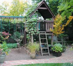 Perfectly integrated into the flower garden. #playhousesforoutside #kidsoutdoorplayhouse