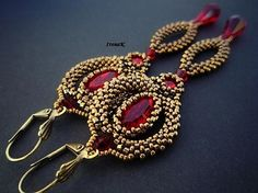 Indian dance. Ruby red and bronze earrings.