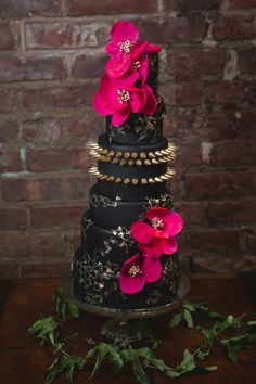 Rock star studded black wedding cake from Lael Cakes at Punk Rock inspired wedding // Photo by Amy Sims Photography