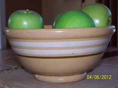 Footed yellowware bowl with white and brown stripes