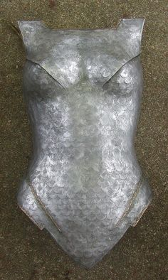 Dark Galadriel Costume. Breastplate made of a plastic half-form display mannequin covered in overlapped round sticker labels. Painted with a layer of thinned down glue, 'metal' spraypaint, and Rub n Buff.