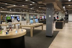 Retail Design | Shop Design | Electrical Store Interior | To the left of this image is the Apple Store in Store. Uniquely designed to fit into Harrods Technology's design
