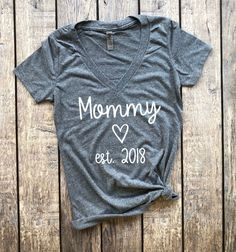 Mommy est. 2018 (V-Neck), mommy to be, pregnancy announcement, pregnancy reveal, baby announcement, does this shirt make me look pregnant, pregnancy shirt, maternity shirt, mama bear, mommy to be #pregnancyannouncementshirts,