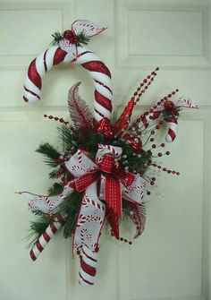Top Candy Cane Christmas Decorations Ideas - Christmas Celebration - All about Christmas Candy Cane Decorations, Front Door Christmas Decorations, Christmas Swags, Christmas Door, Christmas Candy, Holiday Wreaths, All Things Christmas, Christmas Holidays, Christmas Ornaments