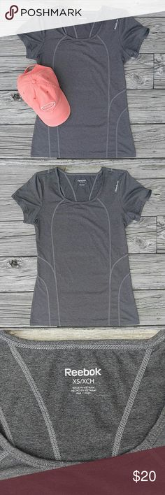 """Reebok Workout Shirt In like-new condition! Armpit to armpit is 17"""" Shoulder to hem is 24"""" Love the item but not the price? Please make an offer! Thanks for looking!  Sorry, no trades or modeling! Reebok Tops Tees - Short Sleeve"""