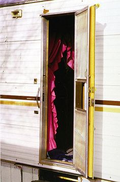William Eggleston  UNTITLED (OPEN DOOR INTO TRAILER, ARIZONA), 1999 - 2000