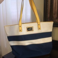Nine West color block canvas tote Like new excellent used condition. Used maybe once. Canvas material. Clean inside and out. Navy blue yellow and tan Nine West Bags Totes