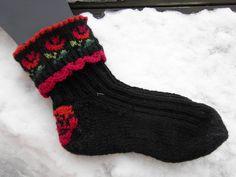 http://www.ravelry.com/patterns/library/lovely--thick-rose-socks---pynteraggen