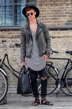 Man wearing leather jacket and fedora