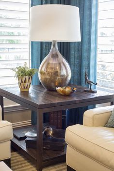 Living room remodel; transitional style; citrine and turquoise; Currey and Co lamp; sofa; Stark rug | Interior Designer: Carla Aston / Photos: Tori Aston