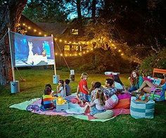 Pass the popcorn! Learn how to host a blockbuster backyard bash, complete with movie trivia, popcorn bar, and a Hollywood-sized screen. outdoor fun Summer Movie Night in Your Backyard Backyard Movie Nights, Outdoor Movie Nights, Outdoor Movie Party, Backyard Movie Party, Outdoor Movie Screen, Movie Projector Outdoor, Outdoor Parties, Kids Movie Party, Movie Theater Party