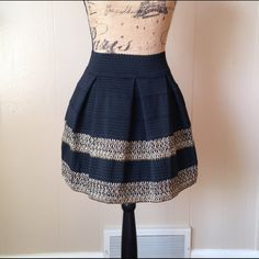 Structured Skirt This gorgeous pleated structured skirt is made of heavy material that allows the skirt to keep its shape and stay in place.                                                       Black with gold & silver detailing.                                                    I do not trade! Skirts A-Line or Full