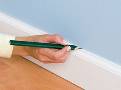 How to Hide Wiring Behind Baseboard or Installing a Raceway : How-To : DIY Network