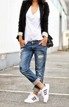 This combo of a black blazer and blue destroyed boyfriend jeans will attract attention for all the right reasons. Dress down your look with white running shoes. Shop this look for $93: http://lookastic.com/women/looks/v-neck-t-shirt-blazer-crossbody-bag-boyfriend-jeans-athletic-shoes/7221 — White V-neck T-shirt — Black Blazer — Black Leather Crossbody Bag — Blue Ripped Boyfriend Jeans — White Athletic Shoes