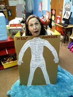 Here's me in our class xray machine.  Provide gloves, masks, and stuff to play doctor. The skeleton is hand drawn to fit the card board.