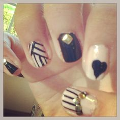 Sweet nude nails with gold studs and fierce black patterns