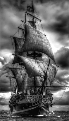 Black and white portrait - Tall Ship a-sea, wind in her sails.