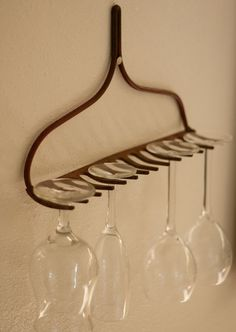 Eco Housekeeping Tip #15: Rake upcycling project.    1. Find an old rake and remove/cut off the handle  2. Hang the rake in your house with a nail, screw, or anything else you can find that will support the rake.  3. Hang stemware from the rake. Impress your friends.