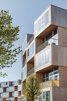 Balconies on the south facade. Tagged: Exterior, Flat RoofLine, Wood Siding Material, and Apartment Building Type. Photo 13 of 15 in This Curving Prefab Building in Copenhagen Contains 66 Affordable Apartments. Architecture Design, Sustainable Architecture, Residential Architecture, Architecture Courtyard, Building Architecture, Landscape Architecture, Building Facade, Building Design, Green Building