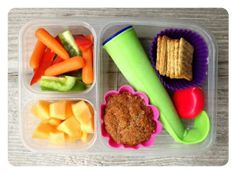 """I almost forgot...today's school lunch! This is what my 8-year-old got: Carrots and bell peppers, cantaloupe, whole-wheat carrot/applesauce muffin, frozen smoothie pop (berries, spinach, yogurt, milk, peanut butter), a little cheese, and some whole grain """"woven wheat"""" crackers (Back to Nature brand)."""