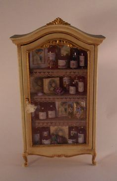 Miniature Filled Perfume Cabinet in 1:12 scale by Pedrete