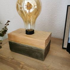 Industrial lamp made of wood and concrete Light Bulb, Boutique, Couches, Lighting, Parfait, Dimensions, Facebook, Home Decor, Budget