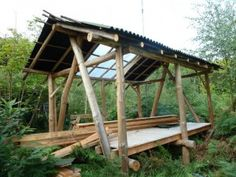 Cruck frame idea for cabin - a round wood frame we think would look great, but inner frame/roof can be timber.