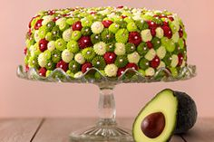 Avocado Cake with Raspberry filling and Key Lime Buttercream Frosting; This moist cake recipe uses Avocado in place of some of the butter or shortening used in a traditional buttermilk cake. It's simply delicious!