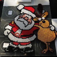 Santa Claus and a Reindeer - Christmas hama perler beads by Dorthe aaskoven Santa And His Reindeer, Reindeer Christmas, Handmade Christmas, Pony Bead Patterns, Hama Beads Patterns, Fuse Beads, Pearler Beads, Christmas Perler Beads, Beaded Banners