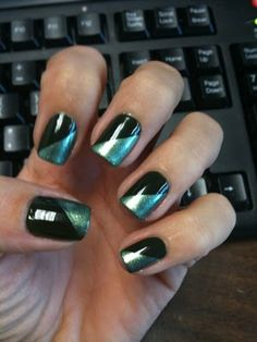 paint your nail a single color (black), place a piece of tape diagonally across the nail, then paint the nail with a different color (silver). remove tape.