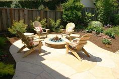 Stone patio with fire pit. Like the chairs and patio size
