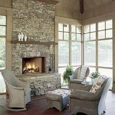 Love the fireplace in this 4 season room! #seasonalrooms  #seasonalroomdesigns homechanneltv.com Decks And Porches, Back Porches, Screened In Porch, Enclosed Porches, Porch Addition, Fireplace Stone, Fireplace On Porch, Fireplace Windows, Simple Fireplace